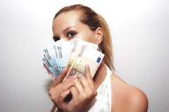Woman with group of money stock photography