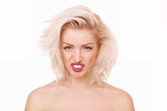 Woman growls. Closeup portrait young woman growls with her mouth open Stock Image