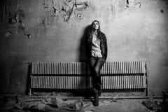 Woman at grunge room Royalty Free Stock Photo