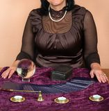 Woman fortune teller. Woman guessing on the Tarot cards at the table Royalty Free Stock Photo