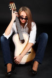 Woman with guitar. Royalty Free Stock Photography