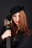 Woman with guitar. Royalty Free Stock Image