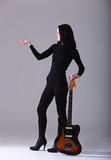 Woman with guitar. Royalty Free Stock Images