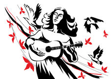 A woman with a guitar. A woman inspired plays guitar on the background of flying birds and leaves Stock Photos