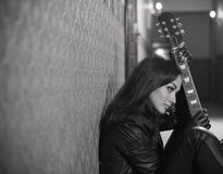 Woman with guitar Stock Images