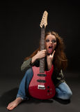 Woman with a guitar royalty free stock photos