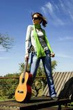 Woman with a guitar Stock Photo