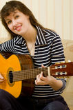 Woman with a guitar Royalty Free Stock Image