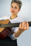 Woman and guitar Royalty Free Stock Photography