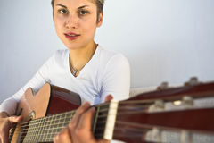 Woman and guitar Stock Photography