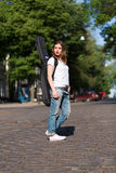 Woman with guitar in the city Royalty Free Stock Photo