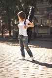 Woman with guitar in the city Royalty Free Stock Images
