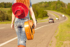 Woman with guitar at freeway Stock Photos