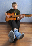 Woman with guitar in house Royalty Free Stock Photos