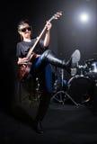 Woman guitar player Stock Photo