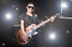 Woman guitar player Stock Images