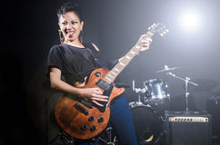 Woman guitar player. During concert Stock Photography