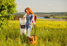 Woman with guitar Royalty Free Stock Photos