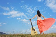 Woman and guitar standing and Cloud sky Royalty Free Stock Photo
