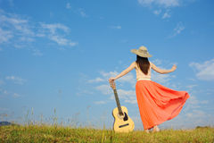 Woman and guitar standing on guitar with Cloud sky Stock Photos