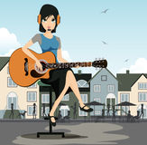 Woman guitarist. With a background as a restaurant Royalty Free Stock Image