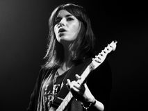 Woman guitarist of Blood Red Shoes (band) performs at Discotheque Razzmatazz. BARCELONA - APR 9: Woman guitarist of Blood Red Shoes (band) performs at Stock Photography