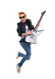 Woman guitarist jumping Royalty Free Stock Photography