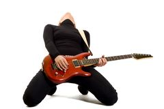 Woman guitarist playing her guitar Stock Image