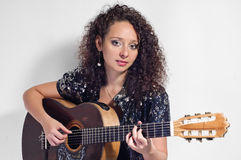 Woman guitarist and singer Royalty Free Stock Photography