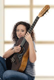 Woman guitarist Royalty Free Stock Photography