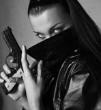 Woman with gun. Black and white photo Royalty Free Stock Image