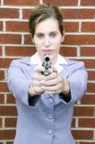 Businesswoman with gun Stock Photography