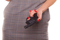 Woman and a gun. Royalty Free Stock Images