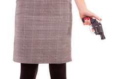 Woman and a gun. Royalty Free Stock Image