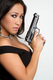Woman With Gun. Pretty chinese woman with gun Royalty Free Stock Photos