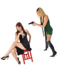 Woman with a gun. Attractive young women one with a gun set on a white background Stock Image