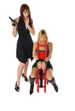 Woman with a gun. Attractive young women one with a gun set on a white background Stock Photography