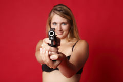 Woman with gun Stock Images