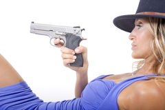 Woman and gun Royalty Free Stock Photography