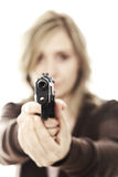 Woman with gun. Portrait of young woman pointing her gun selective focus image Stock Photo