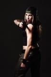 Woman with Gun. Sexy woman with Gun on dark Royalty Free Stock Image