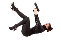Woman and gun. Shot of a beautiful girl posing with a gun Royalty Free Stock Photo