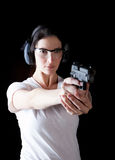 Woman gun. Woman aiming a gun with protective gear Royalty Free Stock Image