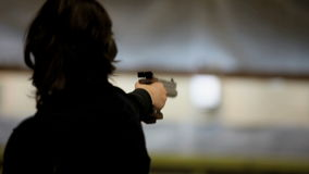 Woman with gun stock video footage