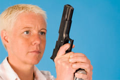 Woman with gun Royalty Free Stock Photos