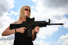 Woman with gun Stock Image