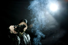 Woman with gun. Woman detective pointing a gun, mystery atmosphere Royalty Free Stock Photography
