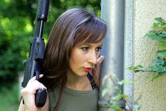 Woman with Gun Royalty Free Stock Image