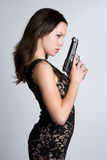 Woman With Gun. Beautiful pretty woman with gun Stock Images