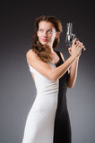 Woman with gun against Stock Images